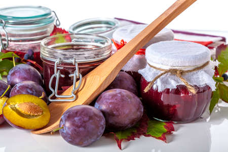 Organic plums and fresh homemade jam on white background Stock Photo - 23007199
