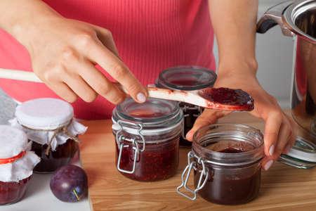 Housewife preparing fresh homemade plum jam Stock Photo - 23049377