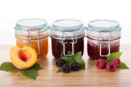 Home-made peach, blackberry and raspberry jams Stock Photo