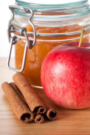 Closeup of an apple, cinnamon and jar of jam Stock Photo - 23007207