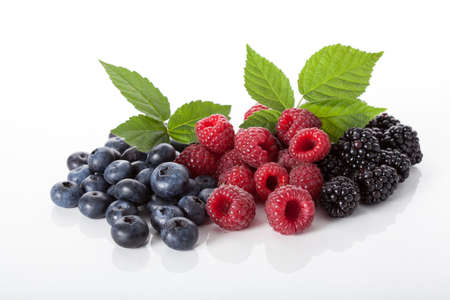 blackberries: Bluberries, raspberries and blackberries on white isolated background Stock Photo