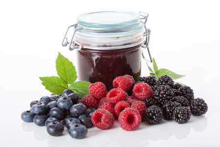 Fresh berries and jar of a homemade jam Stock Photo - 23007431