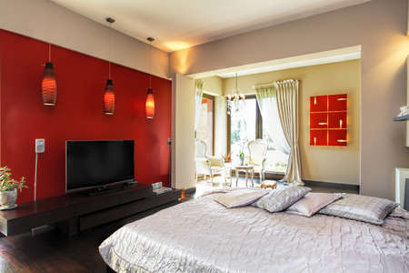 Interior of a modern red and white bedroom photo