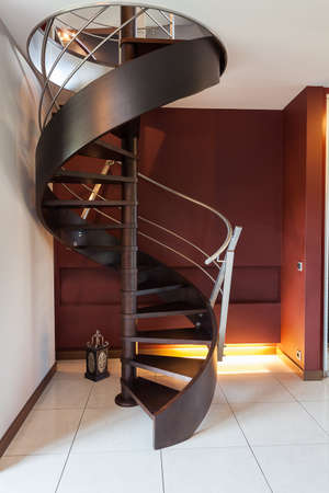 Spiral wooden staircase in a modern luxury house photo
