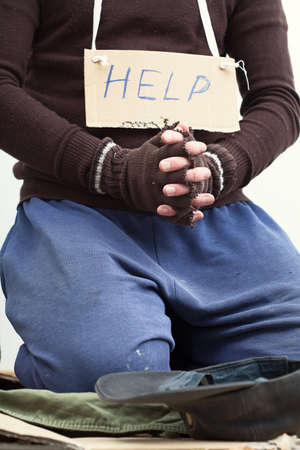 Mendicant on a street begging for help photo