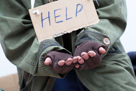Poor pauper begging for help  Stock Photo - 23049402