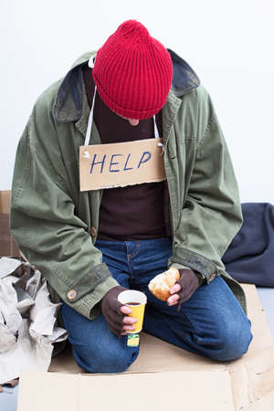 destitution: Homeless man eating his modest meal Stock Photo