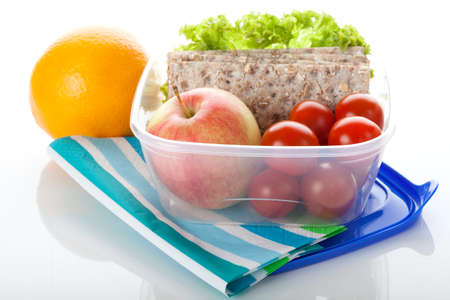 plastic box: Lunch box with healthy food on white isolated background