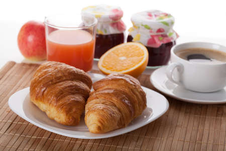 Coffee break with croissants and fresh juice photo
