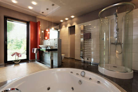 bathroom tile: Luxury bathroom with bath and glass shower