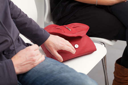 petty theft: The pickpocket is going to steal the woman
