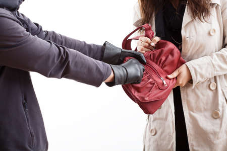 The masked man is stealing a woman Stock Photo - 23080319