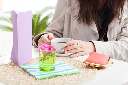 The careless woman is sitting at cafe with purse on the table Stock Photo - 23080321