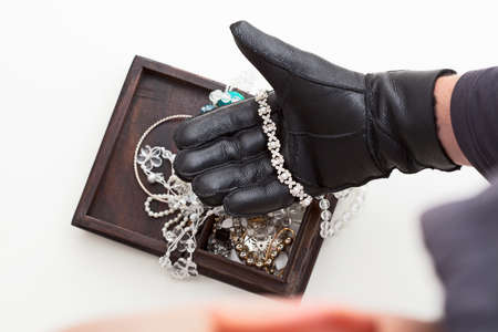 Burglar is stealing expensive jewelry