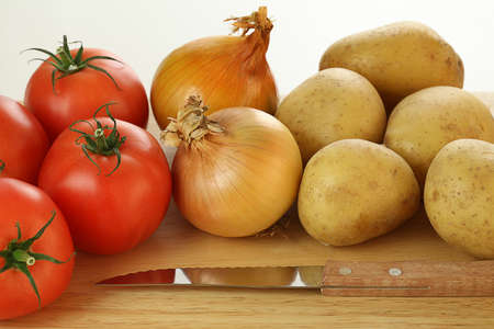Vegetables on a plank next to the knife Stock Photo - 23256214