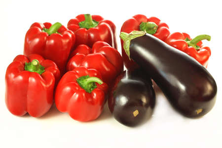 Isolated close up of aubergines and red sweet paprikas Stock Photo - 23256215