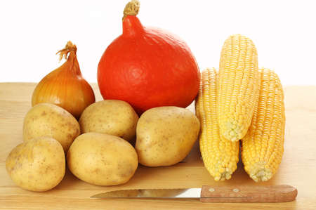 Bulbs of vegetables on a plank next to the knife Stock Photo - 23256222