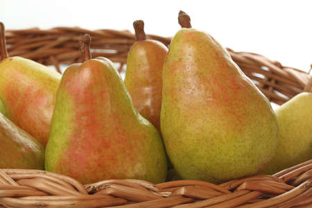 Brown basket full of colourful autumn pears Stock Photo - 23256304