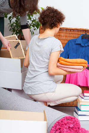 living thing: Mother and dother are packing things to girl moving out