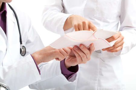 Doctors discussing a medical examination results of a patient Stock Photo - 23256485