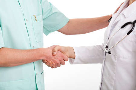 Doctors are shaking hands to say thank you for good teamwork Stock Photo - 23256500