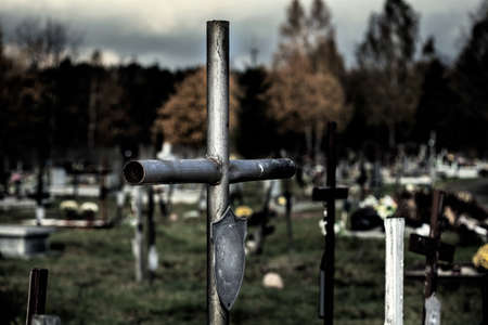 Close up of silver cross located at cemetery Stock Photo - 23256530