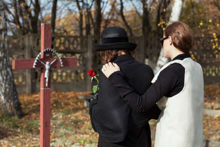 grieving: Two women grieving following loss of family memeber
