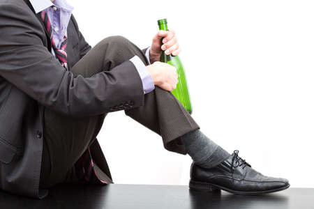 drinking problem: Alcoholic after work drinking wine, isolated background