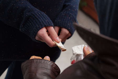 illegal drug: Drug dealer taking money for heroine and ecstasy