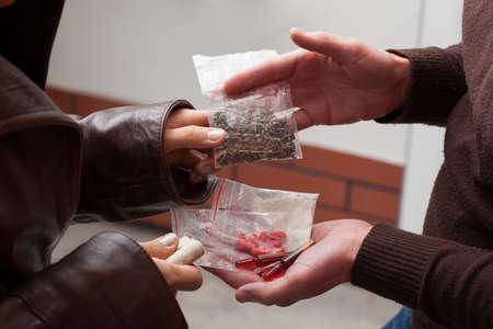 illegal drug: Drug dealer convincing to take his drugs