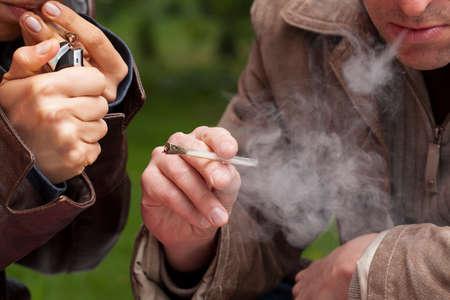 smoking pipe: People smoking maijuana from a pipe