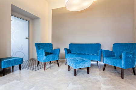 pouf: Original blue sofa, armchairs and pouf in living room Stock Photo