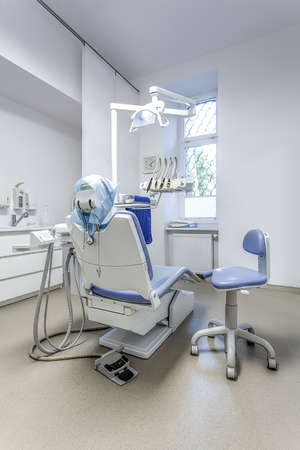 Vertical view of a seat and tools in dental office photo