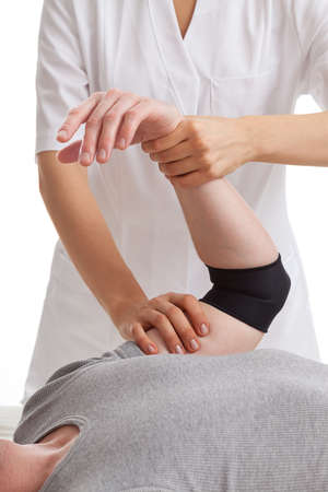physical therapist: Woman doctor massage mans hand Stock Photo