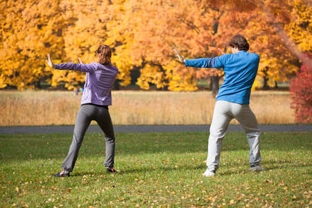 tai chi: People exercising in park, autumn in the city