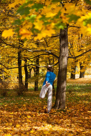 Man doing outdoor sport in colorful autumn photo