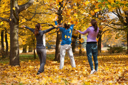 Colorful autumn fun after outdoor sport in park photo