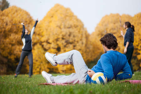 Outdoor sport in park in beautiful autumn photo