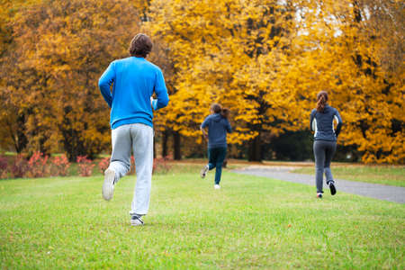 Group of friends jogging outdoor in park photo
