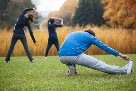 sports coach: Outdoor sport: practicing yoga in the park