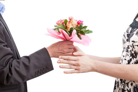 recieving: A woman recieving a bouquet of pink flowers from her husband