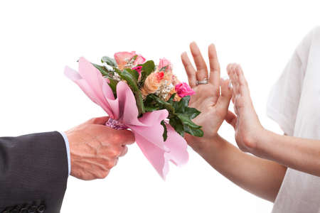 refusing: A woman refusing to accept a bunch of roses