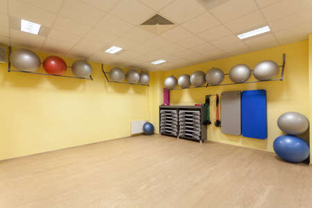 Fitness gym interior with new equipment, horizontal photo
