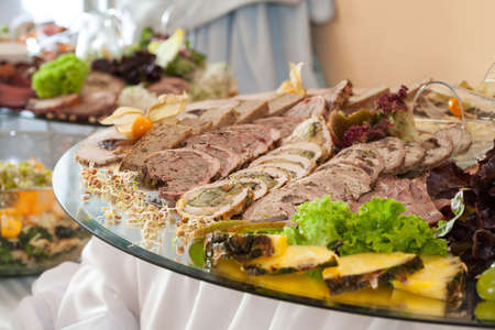 Appetizing slices of meat on a decorated wedding table photo