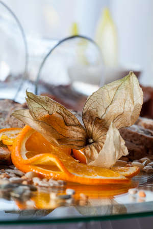 Orange decoration on plate with appetizers photo