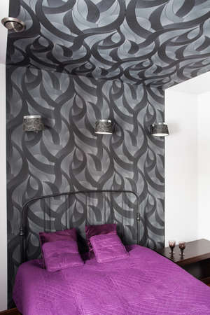 patterned wallpaper: Country home - bedroom with grey patterned wallpaper Stock Photo