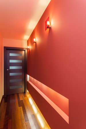 Spacious apartment - Long and red corridor photo