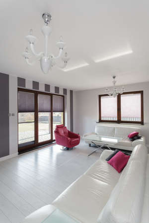 Vibrant cottage - interior of spacious bright living room photo