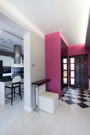 vibrant cottage: Vibrant cottage - pink corridor and white kitchen