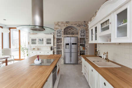 mediterranean houses: Tuscany - countertop, commode and refrigerator in kitchen